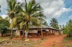 Zanzibar village corner with people passing by Royalty Free Stock Photo