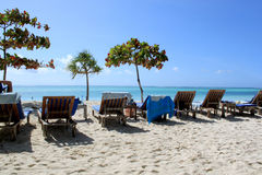 Zanzibar White Sandy Beach And Wooden Chairs Stock Photography
