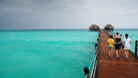 Zanzibar - Wood pier in the tropical sea. Zanzibar - Tanzania - Walking on the wood pier in the tropical sea - Indian Ocean stock images