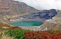 Zao Okama Crater Lake. This natural lake formed in the crater of a volcano is the symbol of Mt. Zao. It is 27 meters deep and 1,000 meters in perimeter, and it Stock Photos