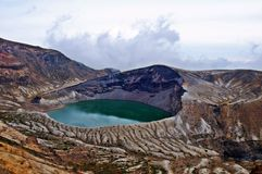 Zao Okama Crater Lake. This natural lake formed in the crater of a volcano is the symbol of Mt. Zao. It is 27 meters deep and 1,000 meters in perimeter, and it Royalty Free Stock Photo
