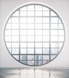 Zaokrąglony okno z miasto widoku przodem Fotografia Stock