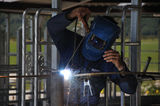 Zap!!. Man spot welding temporary framework in new dairy Stock Photos