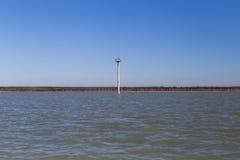 Border post tower in Rio Grande River indicating the border line. Zapata, TX - February 17, 2017: A concrete post found in Falcon Lake, a portion of Rio Grande Stock Image