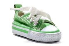 Zapatilla de deporte verde fotos de archivo