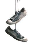 Zapatillas de deporte colgadas Foto de archivo libre de regalías