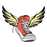 Zapatillas de deporte con las alas aisladas en el fondo blanco, Fotos de archivo libres de regalías