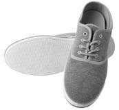 Zapatillas de deporte grises aisladas Fotografía de archivo libre de regalías