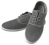 Zapatillas de deporte grises aisladas Fotos de archivo libres de regalías