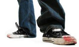 Zapatillas de deporte muy gastadas Fotos de archivo