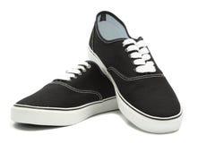 Zapatillas de deporte negras de la lona Foto de archivo