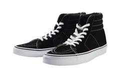 Zapatillas de deporte negras de la lona del top del alto imagenes de archivo