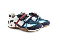 Zapatillas de deporte para el niño Imagenes de archivo