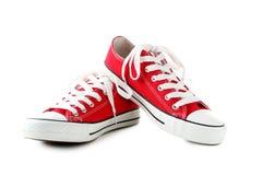 Zapatillas de deporte rojas fotografía de archivo