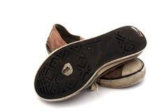 Zapatillas de deporte viejas Imágenes de archivo libres de regalías