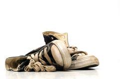 Zapatillas de deporte viejas de la lona o zapatos corrientes Fotos de archivo