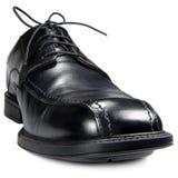 Zapato clásico del club del negro del ` s de los hombres, primer macro granangular detallado aislado, detalle grande Imagen de archivo