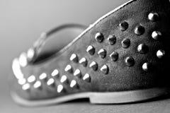 Zapato con los pernos prisioneros Fotografía de archivo