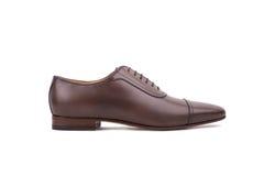 Zapato de cuero de Brown aislado en el fondo blanco Imagenes de archivo