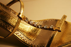 Zapato de oro Imagen de archivo