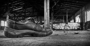 Zapato de trabajo viejo Imágenes de archivo libres de regalías