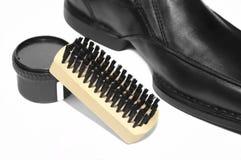 Zapato y crema del pulimento Fotos de archivo