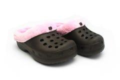 Zapatos aislados del caucho de las niñas Foto de archivo