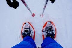 Zapatos anaranjados de la nieve Fotos de archivo libres de regalías