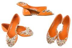 Zapatos anaranjados para la muchacha Fotos de archivo