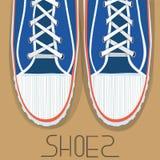 Zapatos azules del deporte Imágenes de archivo libres de regalías