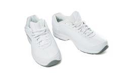 Zapatos blancos del deporte Imagenes de archivo