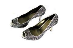 Zapatos brillantes de plata imágenes de archivo libres de regalías