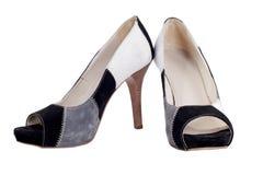 Zapatos con los talones aislados fotografía de archivo