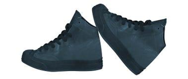 Zapatos corrientes aislados en blanco imagen de archivo