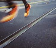 Zapatos corrientes de la naranja del atlethics Foto de archivo libre de regalías