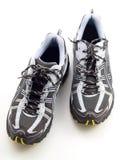 Zapatos corrientes rayados en la visión superior blanca Imágenes de archivo libres de regalías