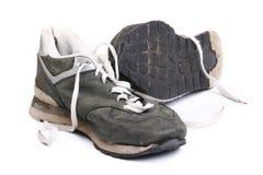 Zapatos corrientes sucios viejos Foto de archivo