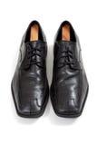Zapatos de alineada de los Mens en un fondo del whte Fotografía de archivo