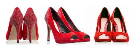 Zapatos de alineada rojos sobre blanco Fotos de archivo libres de regalías