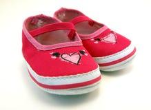 Zapatos de bebé rosados Fotos de archivo