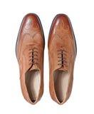 Zapatos de cuero marrones de Menâs aislados en un blanco Imagen de archivo libre de regalías