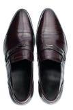 Zapatos de cuero marrones masculinos clásicos aislados en un blanco Fotografía de archivo