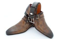 Zapatos de cuero y correa de lujo Imagenes de archivo