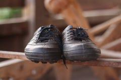 zapatos de goma viejos Imágenes de archivo libres de regalías