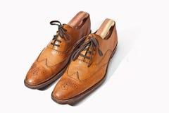 Zapatos de la abarca de Tan del Mens imagenes de archivo