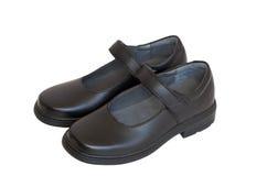 Zapatos de la escuela para la muchacha (aislada) fotografía de archivo