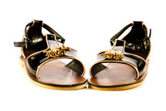 zapatos de las muchachas aislados en los accesorios blancos del fondo Foto de archivo