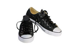 Zapatos de lona negros con el fondo blanco Imagen de archivo