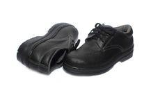 Zapatos de seguridad aislados en el fondo blanco fotos de archivo libres de regalías