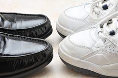 Zapatos de trabajo y zapatos del juego Imágenes de archivo libres de regalías